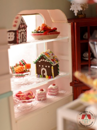 Miniature Christmas goodies on display at the dollhouse bakery